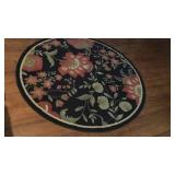 Large Black and Floral Round Rug