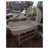 Wicker Bassinet on wooden frame with wheels
