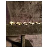 Lot of 5 gold tone rings some faded and missing