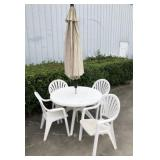 PVC TABLE, 4 CHAIRS AND UMBRELLA