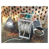 CONTENTS ON BRICK WALL STEP LADDER, HOSE REEL,