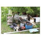 LARGE SCRAP PILE ON THE BACK SIDE OF THE HOUSE