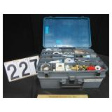 Plumbing composition case with contents