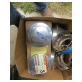 box of old Ford wheel covers, lug nut covers,
