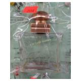 Etched glass perfume bottle