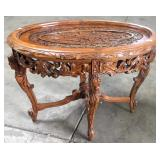 HEAVILY CARVED OVAL TABLE