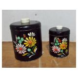 2 VINTAGE BLACK DECORATED CANISTERS