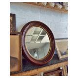 Victorian oval walnut mirror