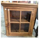 EARLY GLASS FRONT CABINET
