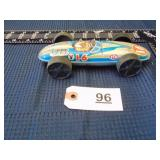 Toy tin race car