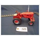 Ertl toy International Farmall tractor