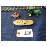 toy John Deere tractor, toy boat, and toy truck