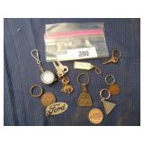 assorted vintage Ford key chains