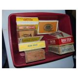 tub of cigar boxes in plastic tote
