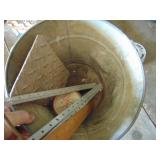 galvanized bucket with miscellaneous items