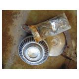 John Deere hubcap (roller stand)