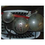 basket of hubcaps & misc