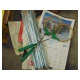 box lot - awning poles, badmitton rackets,