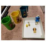 Walt Disney cups & wind-up Smurf