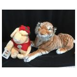 Stuffed tiger and pig