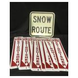 Snow route and fire extinguisher signs