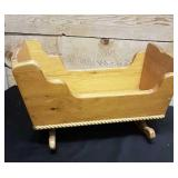 Rocking look sleigh cradle for dolls, plants
