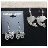 2 pair of pierced earrings.