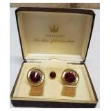 Tie pin and cufflink jewelry set. Ruby colour