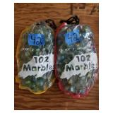 2 Drawstring Bags Of Glass Marbles