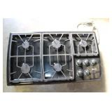 Thermador 5 Burner Cooktop works, has scratches an