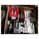 Box full of champion and splitfire spark plugs