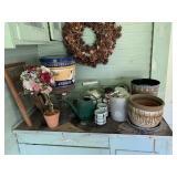 flower pots, wreaths, trash cans, milk bottle,