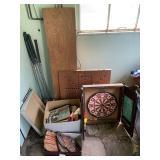 baseball mits, dart board, golf clubs, ammo,