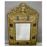Baroque style gilt-metal cushion mirror