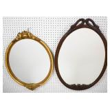2 Oval framed mirrors