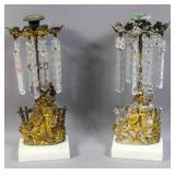 Pair of figural brass candle holders