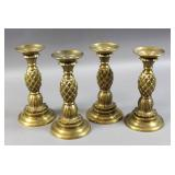 Set of 4 brass candlesticks