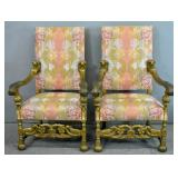 Pair of carved wood upholstered throne chairs