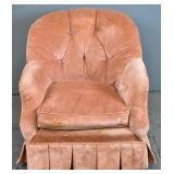 Salmon upholstered and tufted club chair