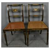Pair of Regency painted and caned side chairs