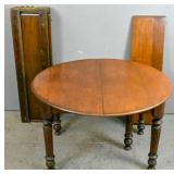Draw-leaf mahogany-stained dining table