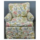 Floral slip covered armchair on casters