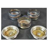 Group of 5 silver plated wine coasters
