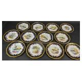 Set of 12 English gilt-decorated fish plates