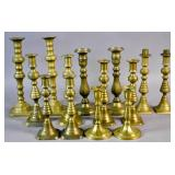 7 Pairs of brass candlesticks