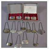 Group of sterling and English silver decanter tags