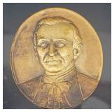 Oval bronze plaque of clergyman
