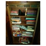 contents of book shelf including The Best of Taste