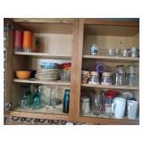 contents of upper cupboard - shot glasses, ice tea
