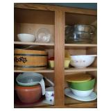 contents of cupboard - Pyrex colored bowls and